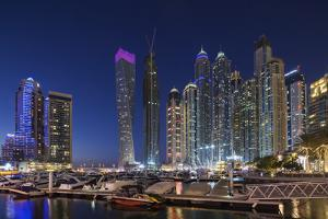 UAE, Dubai Marina high-rise buildings including the twisted Cayan Tower by Walter Bibikow