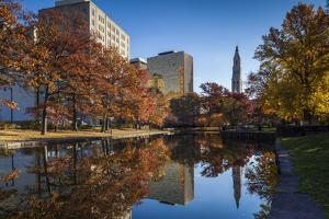 USA, Connecticut, Hartford, Bushnell Park, reflection of office buildings and Travelers Tower by Walter Bibikow