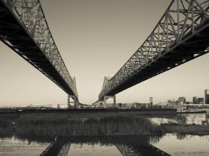 USA, Louisiana, New Orleans, Greater New Orleans Bridge and Mississippi River by Walter Bibikow