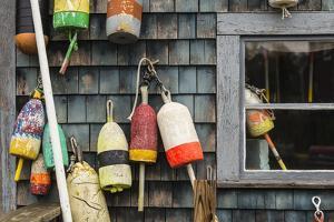 USA, Maine, Mt. Desert Island, Bernard. Lobster buoys. by Walter Bibikow