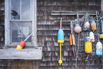 USA, Massachusetts, Cape Ann, Rockport, Lobster Buoys by Walter Bibikow