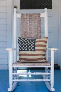 USA, Massachusetts, Cape Cod, Provincetown, the West End, Rocking Chair with Us Flag by Walter Bibikow