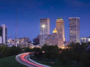 USA, Oklahoma, Tulsa, Skyline from Route 75 by Walter Bibikow