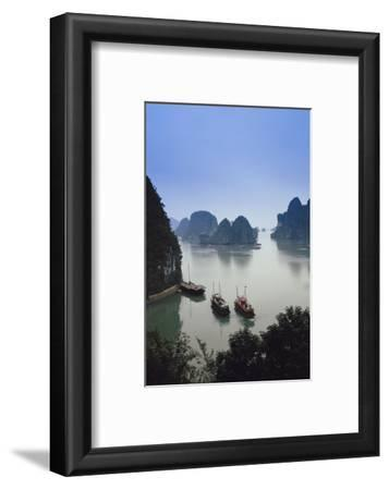 Vietnam, Halong Bay, Tourist Boats Anchor at the Cave of Marvels