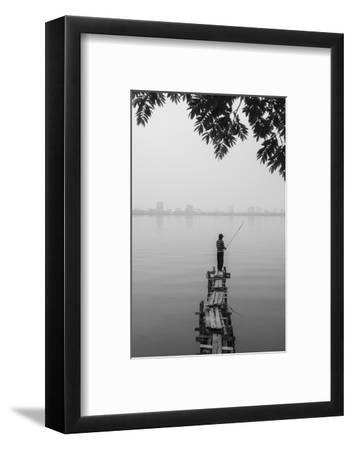 Vietnam, Hanoi. Tay Ho, West Lake, Fisherman