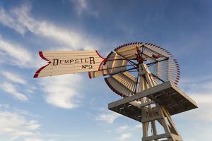 Vintage Farm Windmills at Sunset, Elk City, Oklahoma, USA by Walter Bibikow