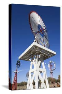 Vintage Farm Windmills, Elk City, Oklahoma, USA by Walter Bibikow