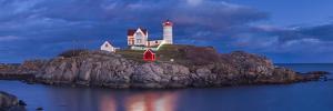 USA, Maine, York Beach, Nubble Light Lighthouse with Christmas decorations, dusk by Walter Bibikw