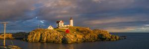 USA, Maine, York Beach, Nubble Light Lighthouse with Christmas decorations, sunset by Walter Bibikw