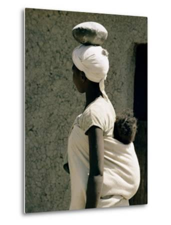 A Xhosa Woman Balances a Container on Her Head and a Baby on Her Back