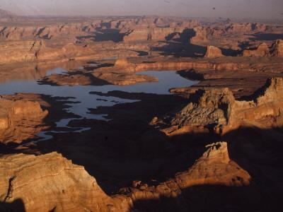 The Waters of Man-Made Lake Powell Rise in Glen Canyon