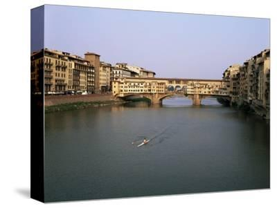 Skiff on the River Arno and the Ponte Vecchio, Florence, Tuscany, Italy