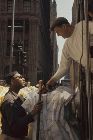 A Pair of Push Boys Unload Racks of Dresses on 7th Avenue, New York, New York, 1960