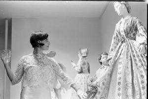Drinking Guest Looking at a Display at the Met Fashion Ball, New York, New York, November 1960 by Walter Sanders