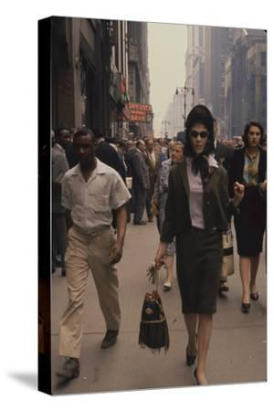 Fashion Model Brigitte Wasserman Walks Along 7th Avenue, New York, New York, 1960