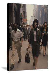 Fashion Model Brigitte Wasserman Walks Along 7th Avenue, New York, New York, 1960 by Walter Sanders