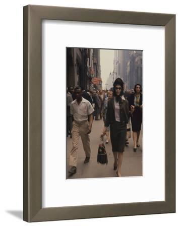 Fashion Model Brigitte Wasserman Walks Along 7th Avenue, New York, New York, 1960