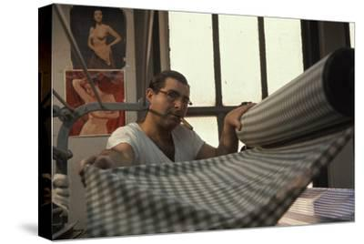 Man Gathers Fabric at the Cindy Collins Inc Sportswear Company, New York, New York, 1960