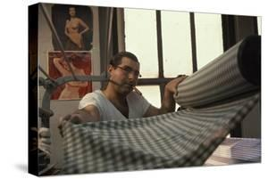 Man Gathers Fabric at the Cindy Collins Inc Sportswear Company, New York, New York, 1960 by Walter Sanders
