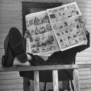 Man Reading the Comics Section of the Detroit Times on a Typical Sunday During WWII by Walter Sanders