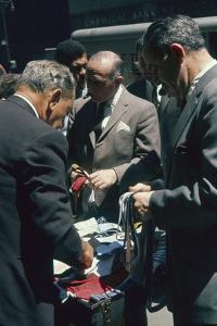Men Sort Through Neckties in a Vendor's Trunk in the Garment District, New York, New York, 1960 by Walter Sanders