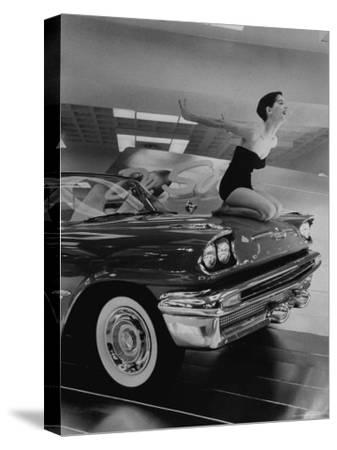Model Jean Littleton in Swimsuit, Posing as Hood Ornament on the Front of a New de Soto Convertible