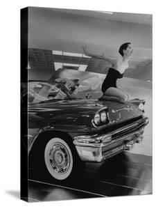 Model Jean Littleton in Swimsuit, Posing as Hood Ornament on the Front of a New de Soto Convertible by Walter Sanders