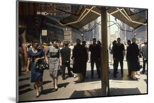 Pedestrians Reflected in Glass on 7th Ave in the Garment District, New York, New York, 1960 by Walter Sanders