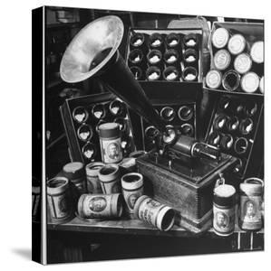 Phonograph Invented by Thomas A. Edison Sitting on Table with Boxes of Cylindrical Records by Walter Sanders