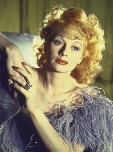 Portrait of Actress Lucille Ball Wearing Blue/Lavender Gown with Feathers by Walter Sanders