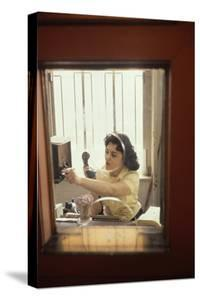 Receptionist Nancy Ricigliano at the Cindy Collins Inc Company, New York, New York, 1960 by Walter Sanders