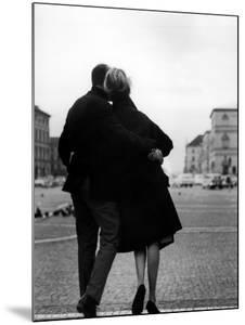 Romantic Couple Walking on the Odeonsplatz by Walter Sanders