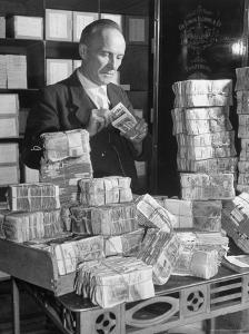 The Chief Cashier Counting Piles of Money by Walter Sanders