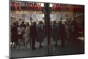 View of Pedestrians Reflected in the Glass of the Hotel York on 7th Ave, New York, New York, 1960 by Walter Sanders