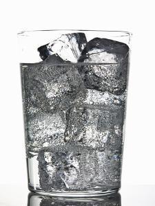 Glass of Ice Cubes in Fizzy Drink by Walter Zerla