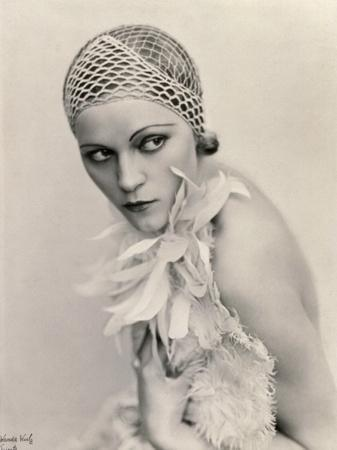 Portrait of a Woman Wearing a Fishnet Hat and a Feather Boa
