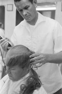 New U.S. Army draft recruit getting his hair cut by a barber, May 15 1967 by Warren K. Leffler
