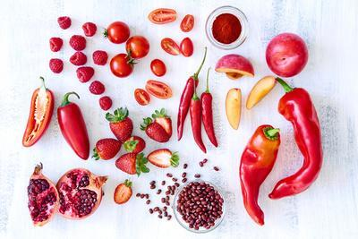 Collection of Fresh Red Toned Vegetables and Fruits Raw Produce on White Rustic Background, Peppers