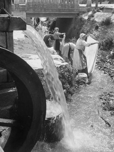 Washerwomen Washing the City's Clothes in the Stream-Walter Sanders-Photographic Print