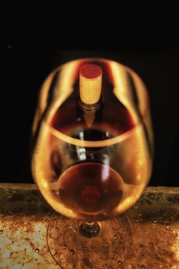 Washington State, Walla Walla. the Illusion of a Bottle Inside a Glass in a Walla Walla Winery-Richard Duval-Photographic Print