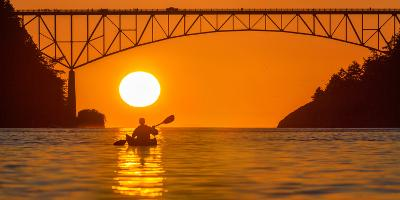 Washington, Woman Sea Kayaker Paddles before the Deception Pass Bridge at Sunset-Gary Luhm-Photographic Print