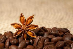 Coffee And Star Anise On Sackcloth Background With Copyspace by wasja