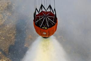 Water Drops are Performed Using Bambi Buckets to Assist the Wildfires in California