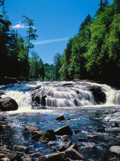 Water flowing from rocks in a forest, Buttermilk Falls, Raquette River, Adirondack Mountains, Ne...--Photographic Print