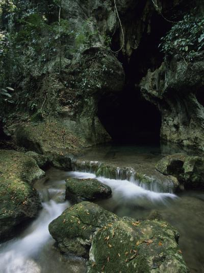 Water Flows from the Mouth of the Tunichil Muknal Cave--Photographic Print