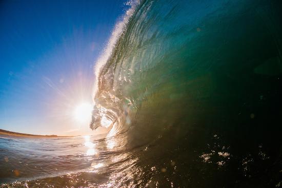 Water shot of a tubing wave off a Hawaiian beach-Mark A Johnson-Photographic Print