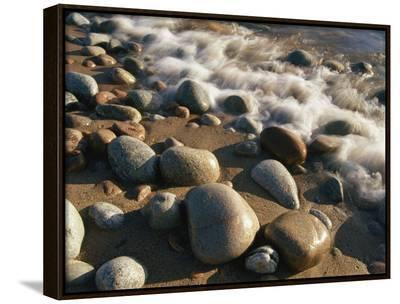 Water Washes up on Smooth Stones Lining a Beach-Michael S^ Lewis-Framed Canvas Print