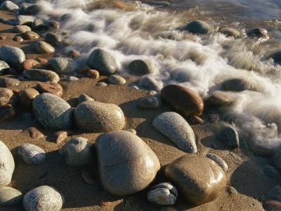 Water Washes up on Smooth Stones Lining a Beach-Michael S^ Lewis-Photographic Print
