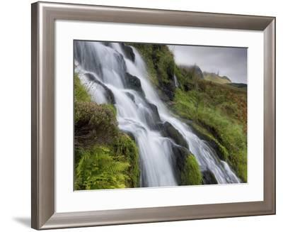 Waterfall Cascading Down Grassy Slope with Old Man of Storr in Background, Near Portree-Lee Frost-Framed Photographic Print