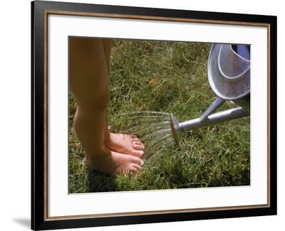 Watering Can Sprinkling Water on Child's Feet-Sally Moskol-Framed Photographic Print